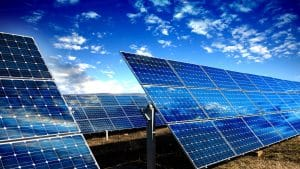 Blue sky and solar panels for an affordable energy source image