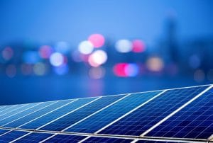 Solar panels and city lights for renewable energy